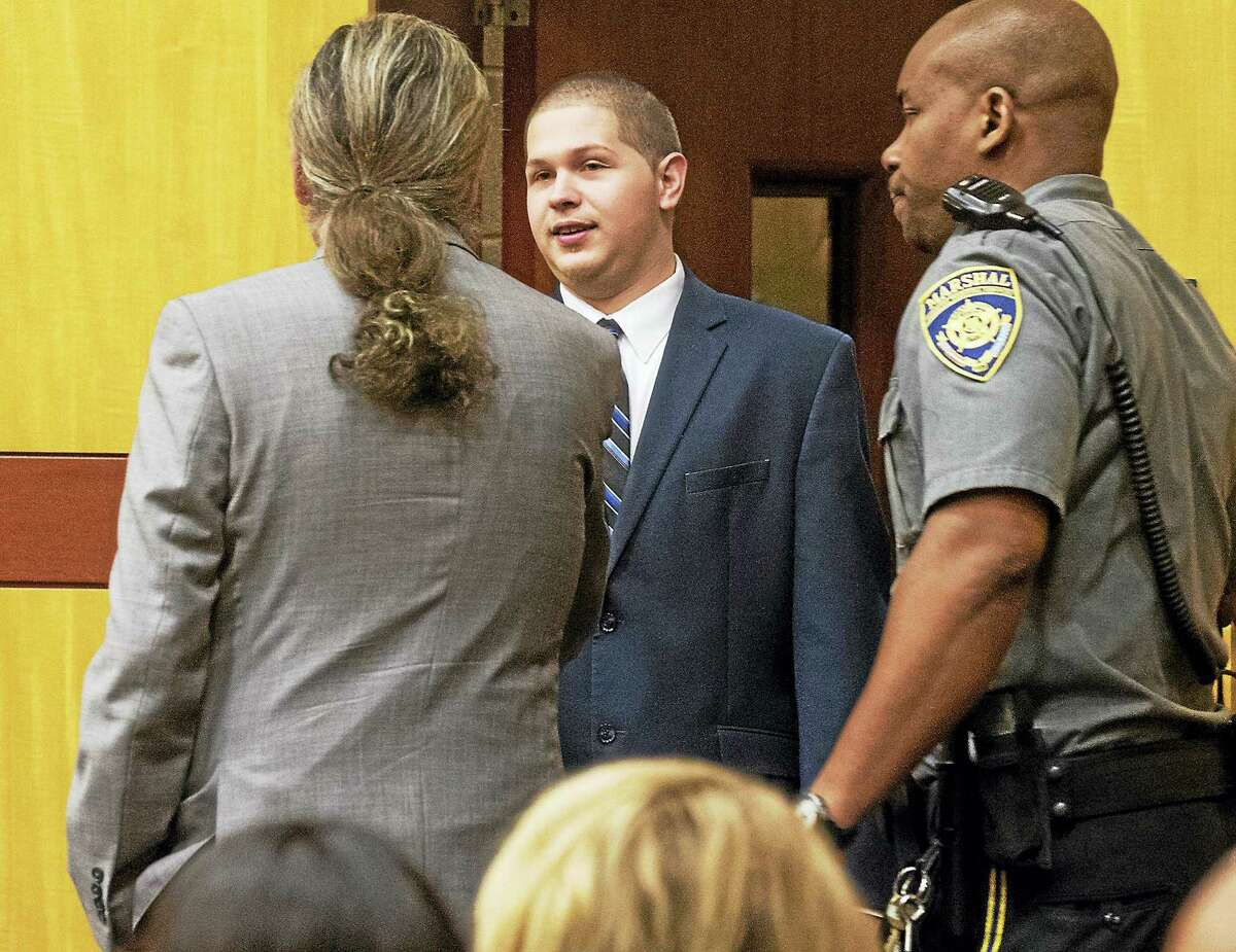 Tony Moreno, 23, is greeted by his attorney, Norm Pattis, as he enters the courtroom in Middlesex Superior Court on Wednesday to be sentenced. Moreno was found guilty of murder and risk of injury to a child in February after throwing his 7-month-old son Aaden to his death from the Arrigoni Bridge on July 5, 2015.