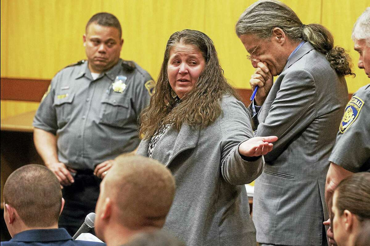 Denise Moreno, the mother of Tony Moreno, cries after speaking on her son's behalf. He was sentenced to 70 years in prison for the murder and risk of injury to his child.