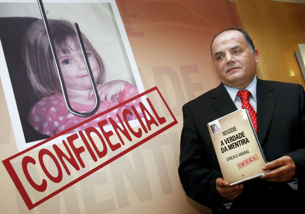 """In this July 24, 2008, file photo, former detective Goncalo Amaral poses with his book whose title translates as """"The Truth in the Lies"""", during its launch in Lisbon. Portugal's Supreme Court has ruled that missing British girl Madeleine McCann's parents can't sue for libel a former Portuguese detective who published a book alleging they were involved in their daughter's disappearance. A court official told The Associated Press on Tuesday, Jan. 31, 2017 that Portugal's highest court ruled the allegations are protected by freedom of expression laws and weren't abusive."""