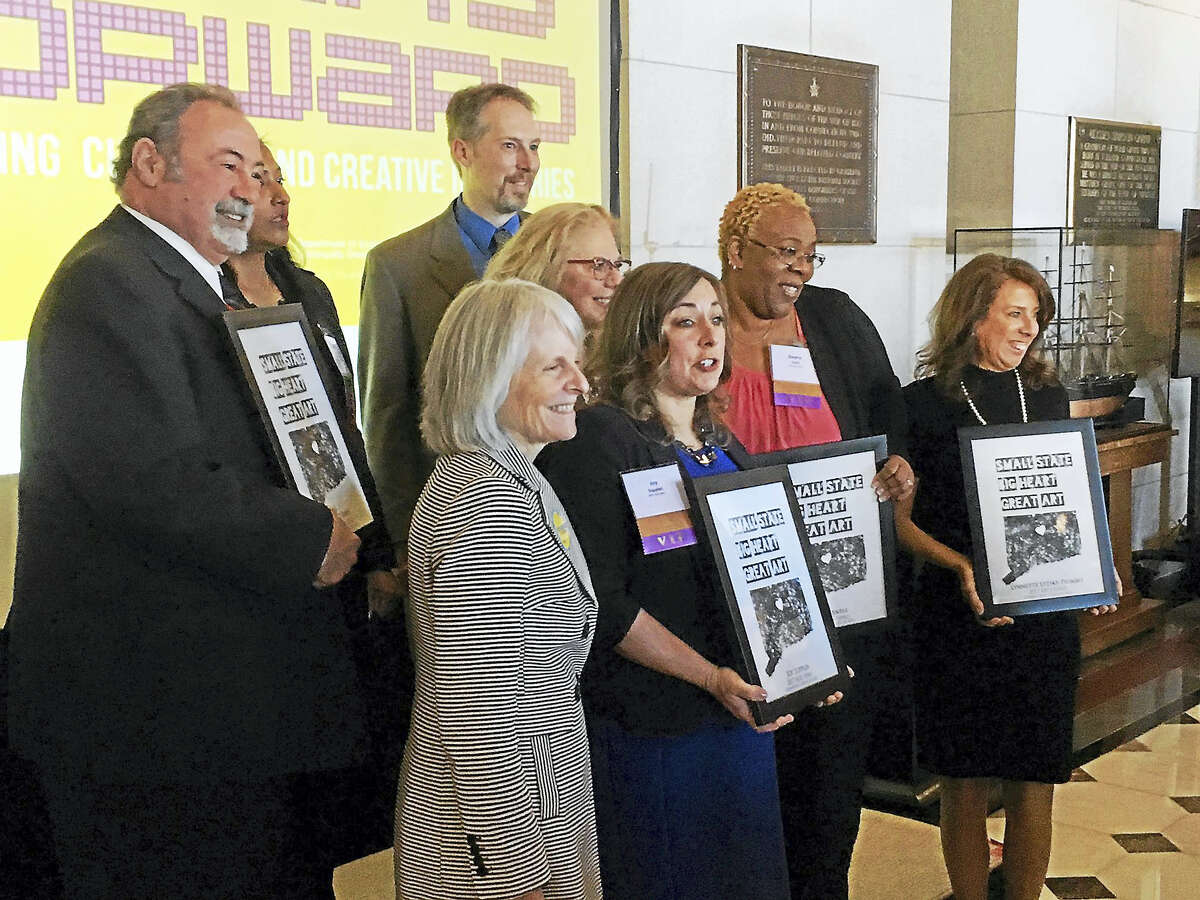 Laurel City Singers director Adam Atkins was one of eight recipients of the Connecticut Art Hero Award, which was presented in Hartford on March 2; Atkins is pictured standing at the right in the back row.