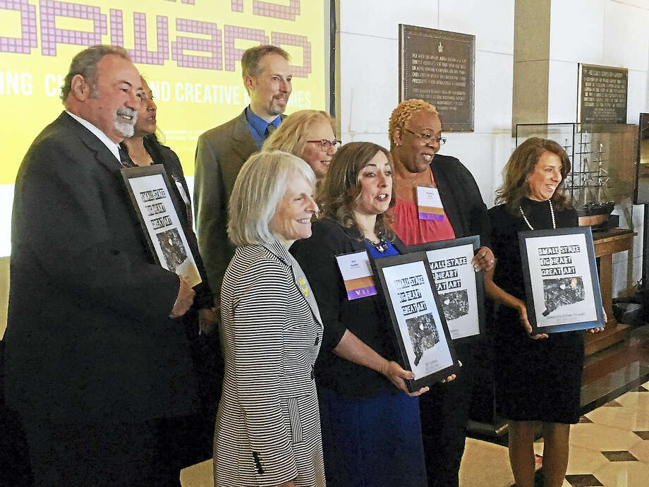 Laurel City Singers director Adam Atkins was one of eight recipients of the Connecticut Art Hero Award, which was presented in Hartford on March 2; Atkins is pictured standing at the right in the back row. Photo: Contributed Photo