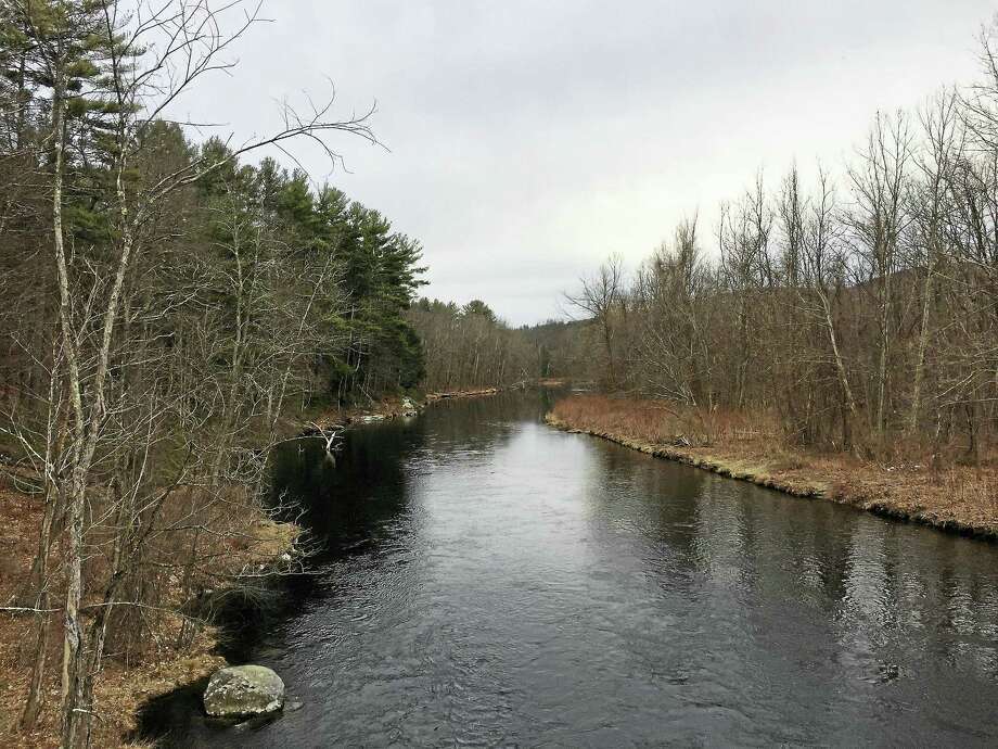 A view of the Farmington River can be seen from Black Bridge Road near the Butler Farm property Thursday. Photo: Ben Lambert — The Register Citizen