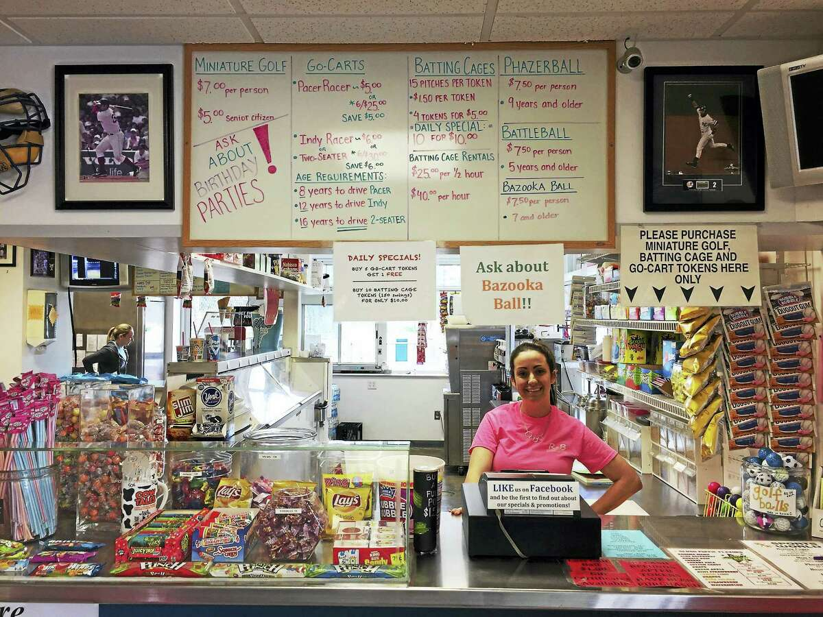Rachel Gagnon stands behind the counter at R&B Sports World in Winsted Wednesday afternoon.