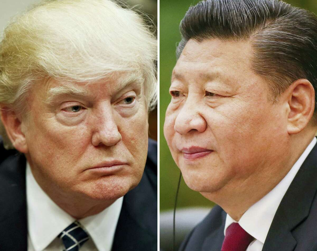 This combination of file photos shows U.S. President Donald Trump on March 28, 2017 in Washington, left, and Chinese President Xi Jinping on Feb. 22, 2017 in Beijing. China said March 30, 2017 that Xi and Trump will meet at the latter's Florida resort on April 6-7. It will be the first in-person meeting between the two.