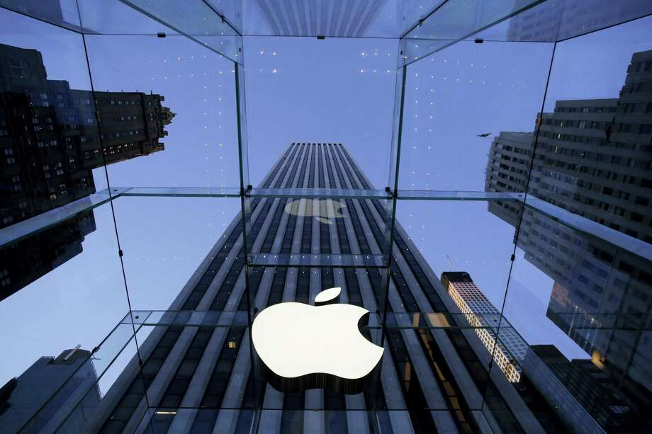 In this Sept. 5, 2014 photo, the Apple logo hangs in the glass box entrance to the company's Fifth Avenue store, in New York. Apple on Wednesday, Oct. 8, 2014 sent invites to an Oct. 16 event during which it's expected to show off new models of its popular iPad and an update to its Mac OS system. Photo: Mark Lennihan — AP Photo  / AP