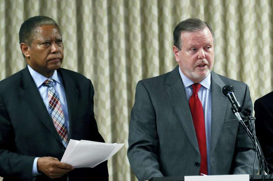 North Carolina Senate President pro tem Phil Berger, right, and Senate Democratic leader Sen. Dan Blue announce a bill to replace the controversial HB2 or 'bathroom bill' at the North Carolina General Assembly on Thursday, March 30, 2017. The bill passed the committee and now goes to the full Senate. Photo: Chris Seward — The News & Observer Via AP  / 2017 The News and Observer