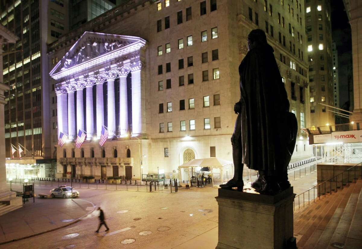 A statue of George Washington stands near The New York Stock Exchange, in background.