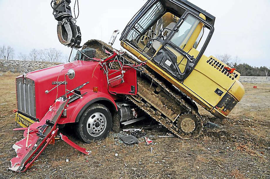 Photos of the aftermath of an incident where an excavator was used to crush a truck in Winsted, released by state police Thursday. Photo: CONTRIBUTED PHOTO