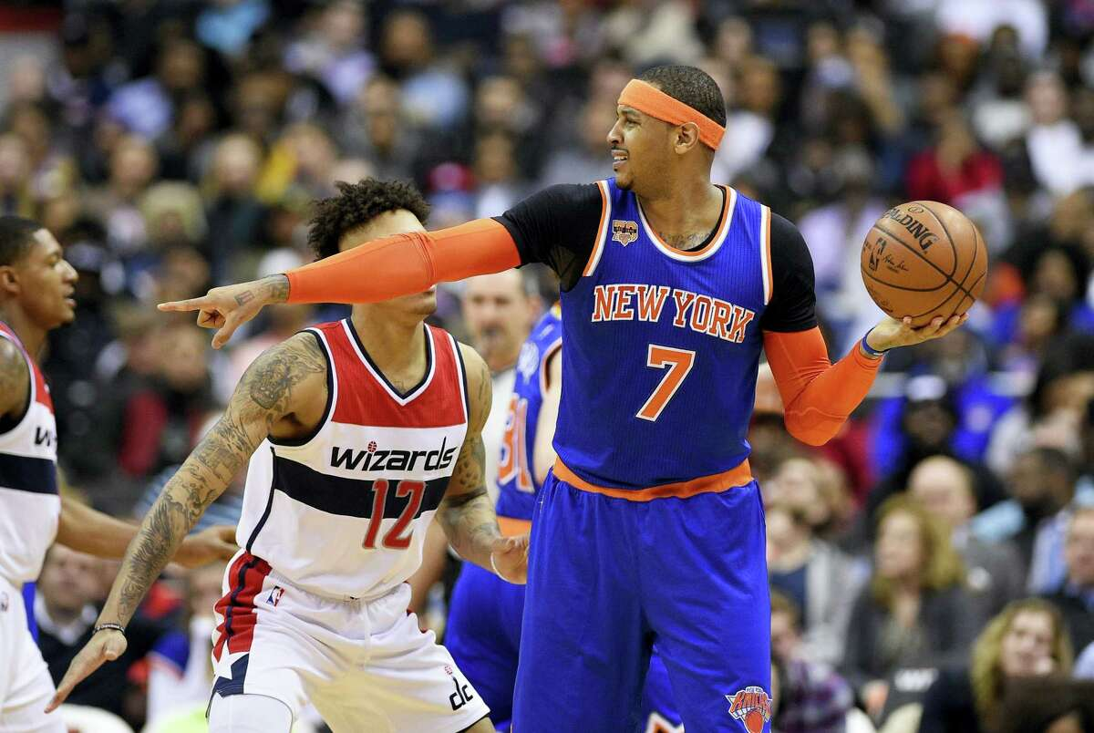 New York Knicks forward Carmelo Anthony points as he holds the ball against Washington Wizards forward Kelly Oubre Jr. (12) during the second half Tuesday in Washington. The Wizards won 117-101.
