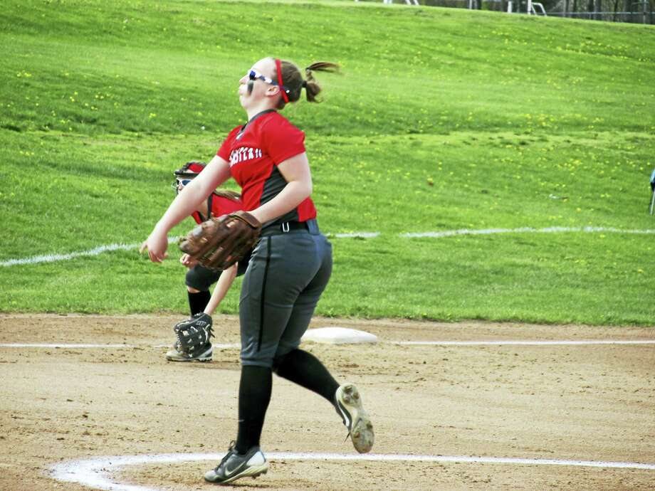 Northwestern pitcher Kate Matava controlled the bottom half of Wamogo's batting order before leaving with a rolled ankle in Tuesday's Highlander win over the Warriors. Photo: Peter Wallace- For The Register Citizen