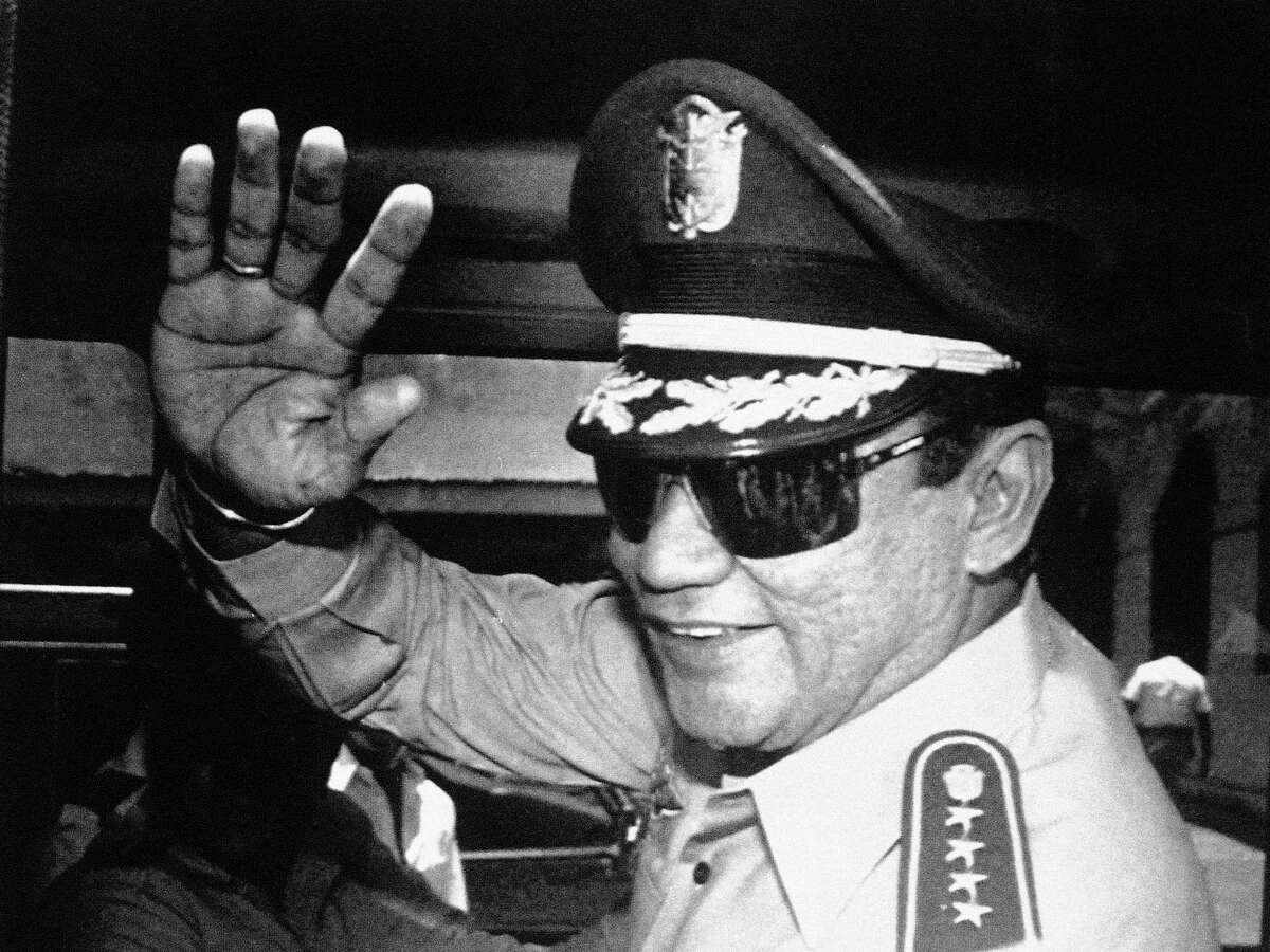 In this Aug. 31, 1989 photo, Gen. Manuel Antonio Noriega waves to newsmen after a state council meeting, at the presidential palace in Panama City, where they announced the new president of the republic. Panama's ex-dictator Noriega died Monday, May 29, 2017 in a hospital in Panama City. He was 83.