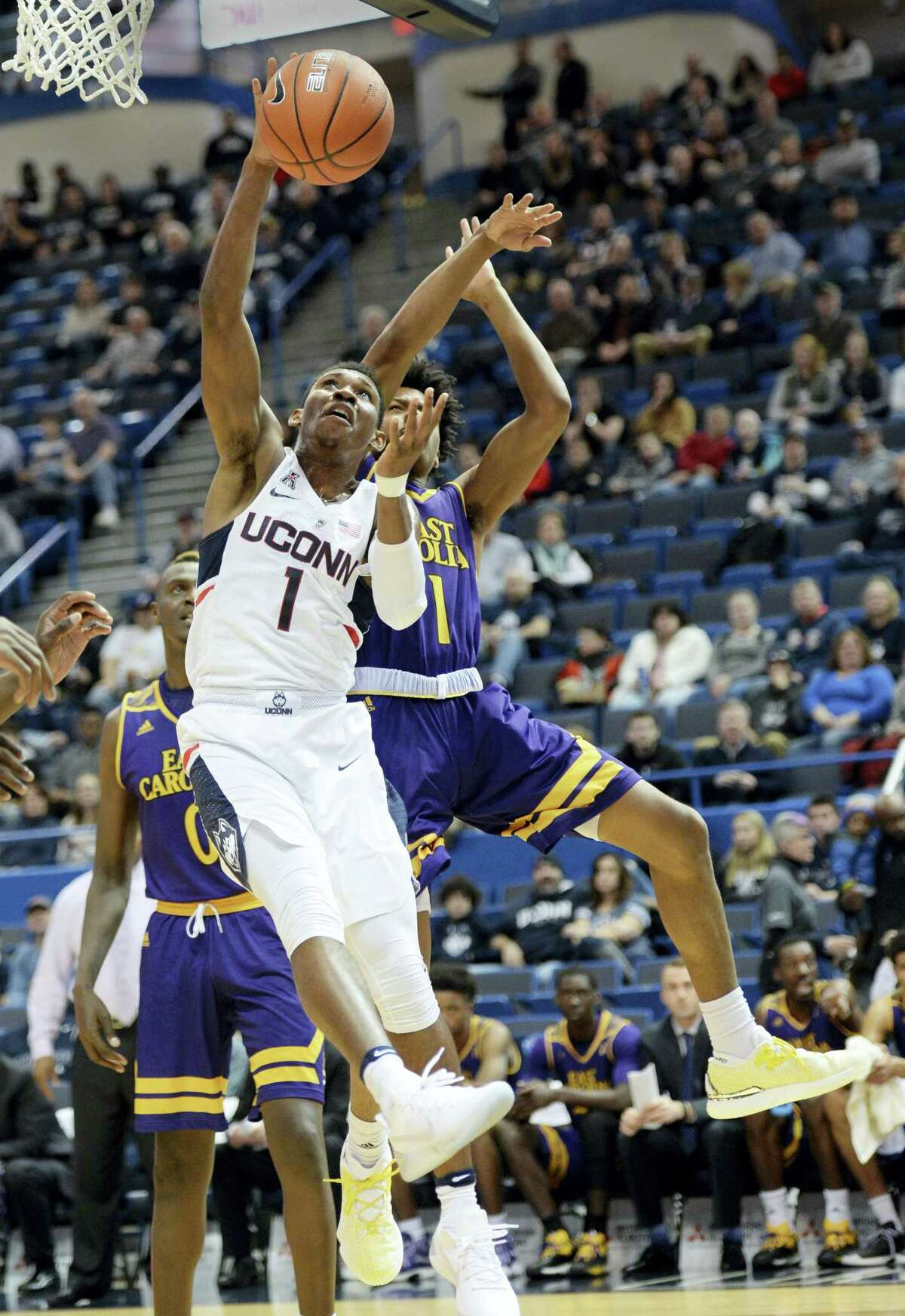 UConn's Christian Vital (1) shoots over East Carolina's Jeremy Sheppard during a recent game.