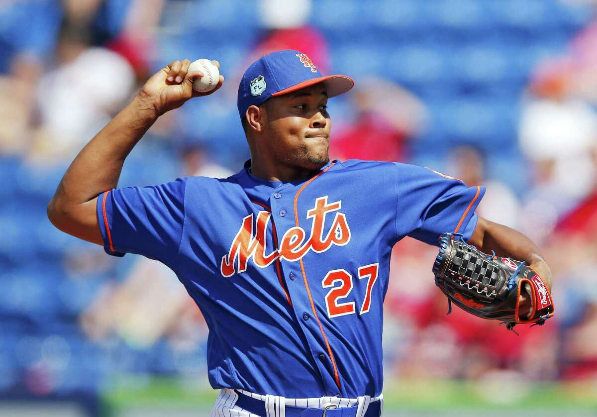 New York Mets relief pitcher Jeurys Familia works against the St. Louis Cardinals in the eighth inning of a spring training baseball game Tuesday in Port St. Lucie, Fla. Familia will be suspended the first 15 games of the regular season under Major League Baseball's domestic violence policy.
