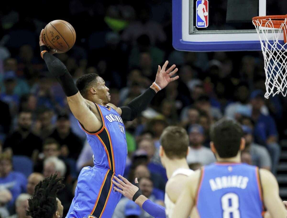 Oklahoma City Thunder's Russell Westbrook dunks the ball against the Orlando Magic during the second half Wednesday. Oklahoma City won 114-106 in overtime.