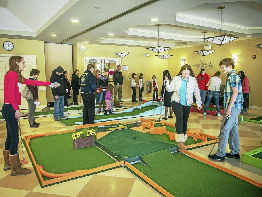 The Woodbury Indoor Mini Golf Open will be held at the Woodbury Senior Community Center, Friday, Feb. 17 through Monday, Feb. 20. Above, participants play at last year's open. Photo: Contributed Photo  / ©2016 David Peter Arnold