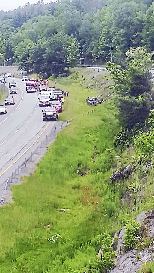 Photos by Jon Thrall A rollover accident was reported on Route 8 south near the Torrington/Harwinton town line on Tuesday afternoon. Photo: Digital First Media