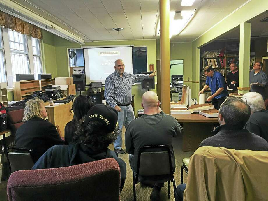 Photos by J. Timothy Quirk WAPJ volunteer John Ramsey leads an orientation discussion at WAPJ radio on Saturday in Torrington. Photo: Digital First Media