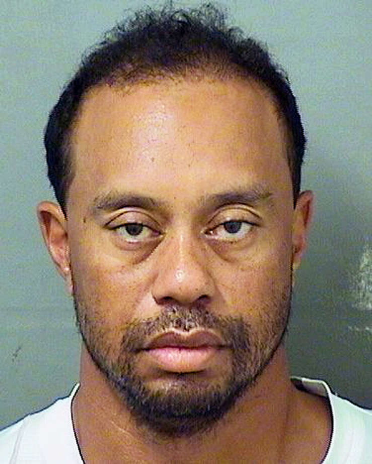 "Palm Beach County Sheriuff's office via AP The mugshot of golfer Tiger Woods arrested for DUI early Monday morning in Florida. Woods said it was an ""unexpected reaction"" to prescription medicine, not alcohol that led to the arrest. Photo: AP / Palm Beach County Sheriff's office"