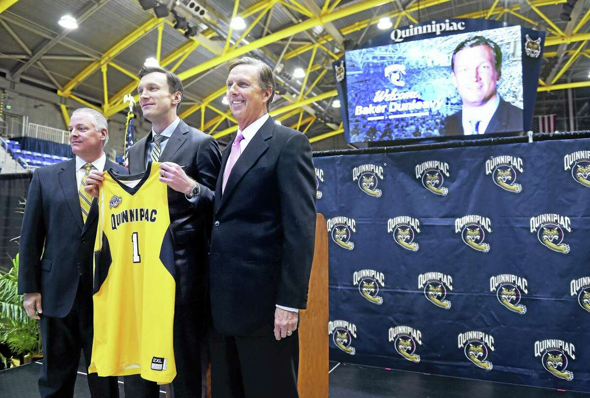 Quinnipiac athletic director Greg Amodio, left, and Quinnipiac president John Lahey, right, are photographed with the new men's basketball coach Baker Dunleavy at the TD Bank Sports Center in Hamden.