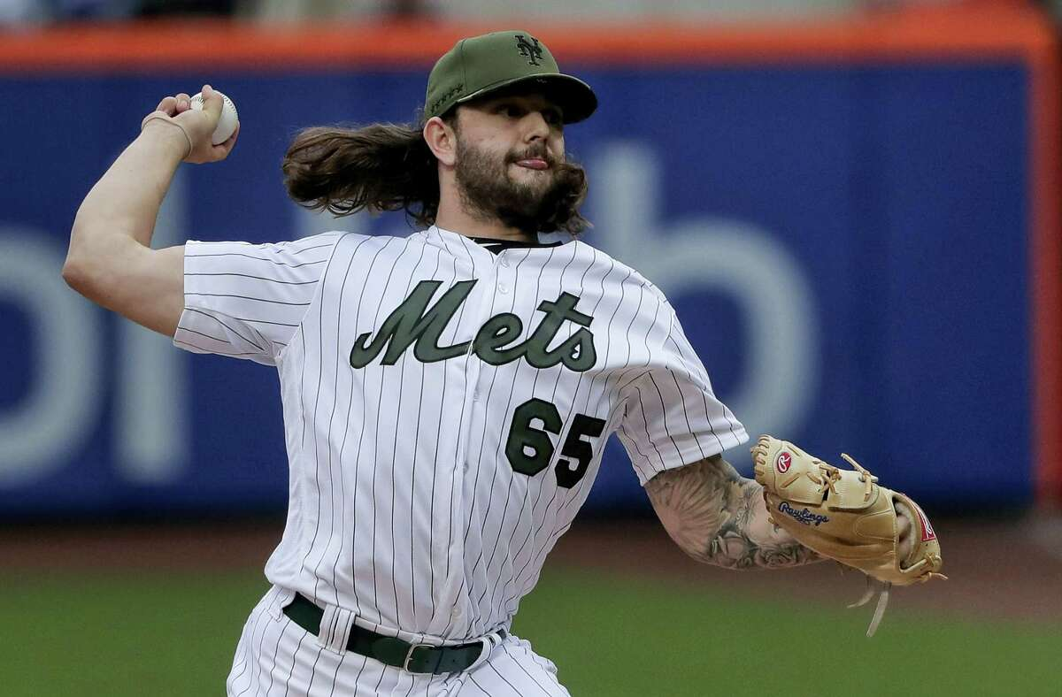 New York Mets pitcher Robert Gsellman (65) delivers against the Milwaukee Brewers during the first inning Monday. Gsellman helped the Mets win 4-2.
