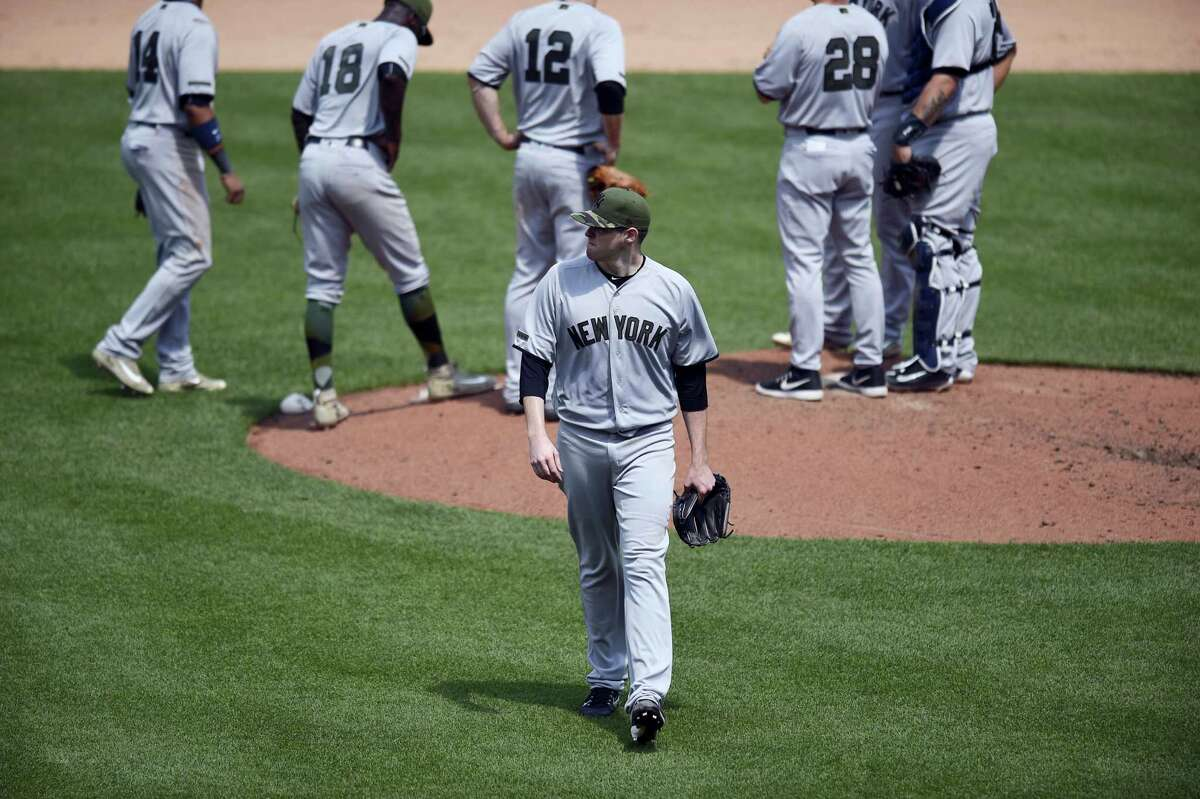 New York Yankees starting pitcher Jordan Montgomery, center, walks to the dugout after he was pulled during the fifth inning against the Baltimore Orioles Monday. The Yankees lost 3-2.