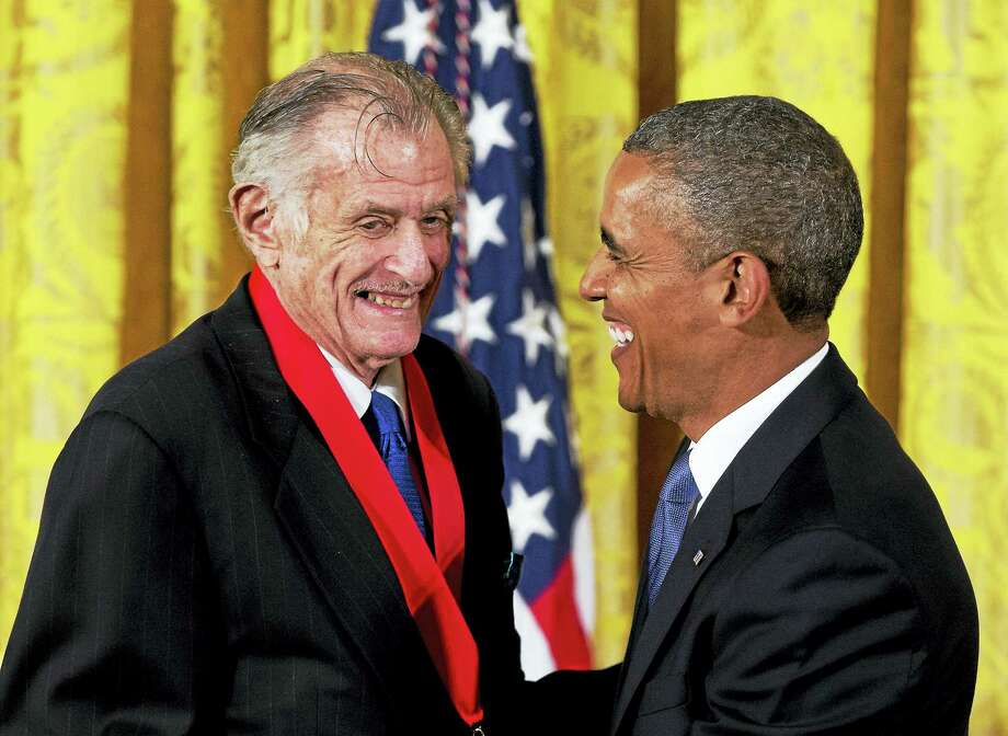 """In this July 10, 2013, file photo, President Barack Obama laughs with Frank Deford as he awards him the 2012 National Humanities Medal during a ceremony in the East Room of White House in Washington. Deford gave his final sports commentary on NPR's """"Morning Edition"""" Wednesday, ending a run of what he calls """"little homilies"""" that began in 1980. Photo: AP Photo/Carolyn Kaster, File   / Copyright 2017 The Associated Press. All rights reserved."""