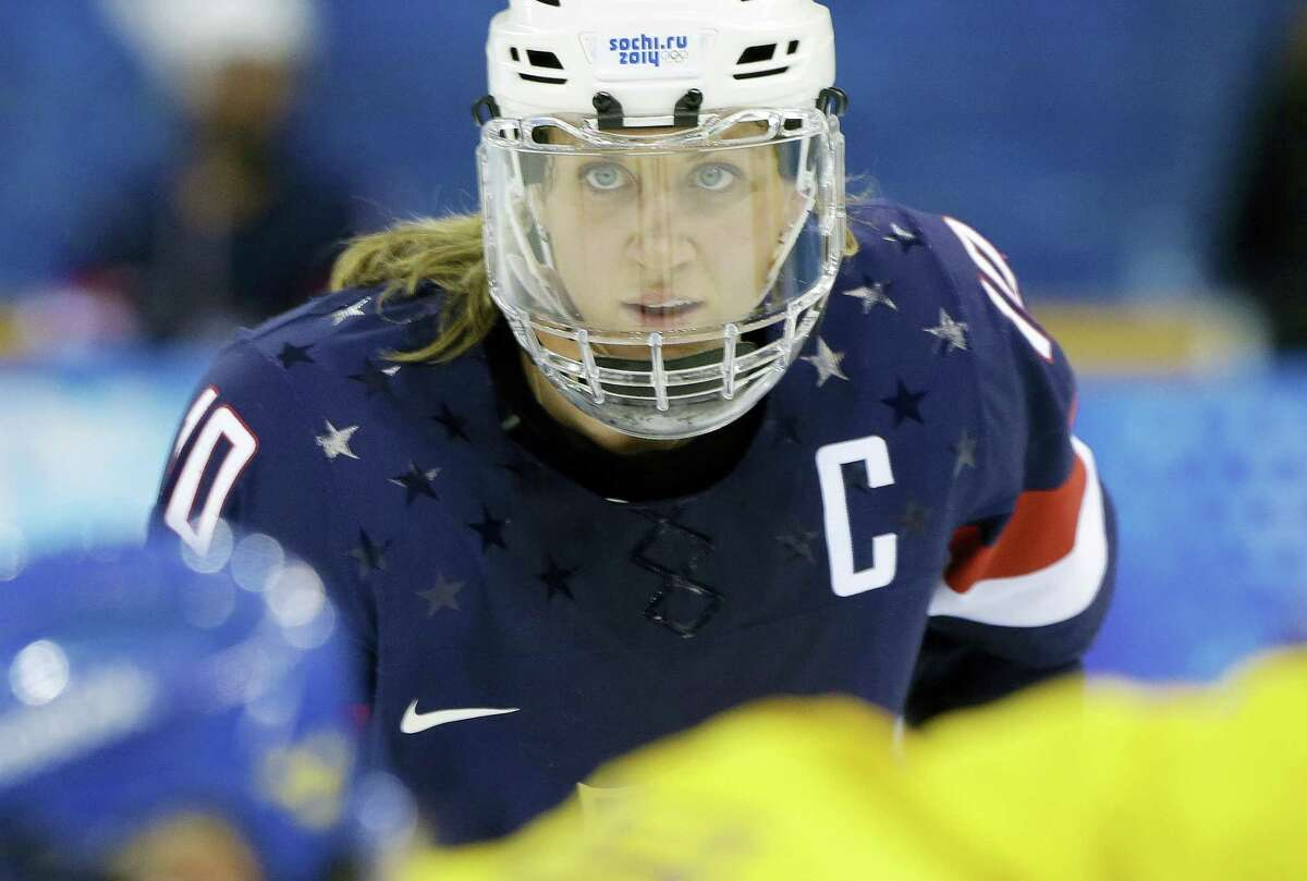 Meghan Duggan of the United States looks up during a face off.