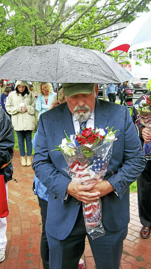 Army veteran Charles Rategan reflects during Winsted's Memorial Day observance. Photo: John Torsiello — Register Citizen