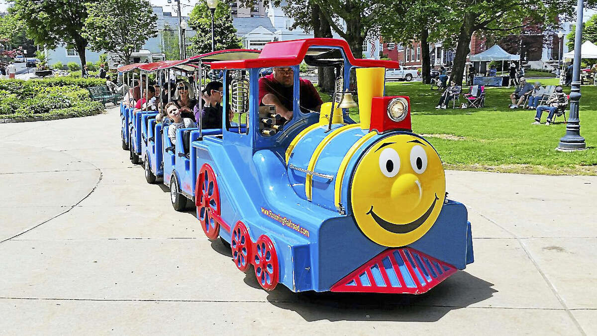 The Main Street Marketplace Express children's train, driven by Rich Audet of Agawam, Massachusetts, took children and parents around the periphery of Coe Memorial Park at the first-ever Saturday in the Park event on Saturday.