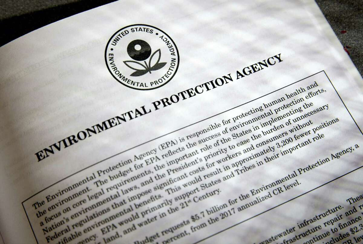 In this March 16, 2017 photo, proposals for the Environmental Protection Agency (EPA) in President Donald Trump's first budget are displayed at the Government Printing Office in Washington. President Donald Trump will sign an executive order on March 29 that will suspend, rescind, or flag for review more than half-a-dozen measures that were part of former President Barack Obama's sweeping plan to curb global warming.