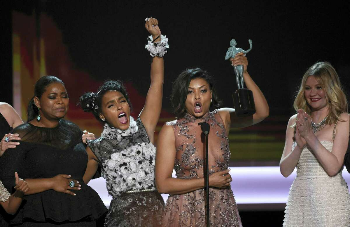 """Octavia Spencer, from left, Janelle Monae, Taraji P. Henson, and Kirsten Dunst accept the award for outstanding performance by a cast in a motion picture for """"Hidden Figures"""" at the 23rd annual Screen Actors Guild Awards at the Shrine Auditorium & Expo Hall on Sunday, Jan. 29, 2017, in Los Angeles. (Photo by Chris Pizzello/Invision/AP)"""