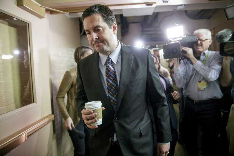 House Intelligence Committee Chairman Rep. Devin Nunes, R-Calif., is pursued by reporters as he arrives for a weekly meeting of the Republican Conference with House Speaker Paul Ryan and the GOP leadership on March 28, 2017 on Capitol Hill in Washington. Nunes is facing growing calls to step away from the panel's Russia investigation as revelations about a secret source meeting on White House grounds raised questions about his and the panel's independence. Photo: AP Photo — J. Scott Applewhite  / Copyright 2017 The Associated Press. All rights reserved.