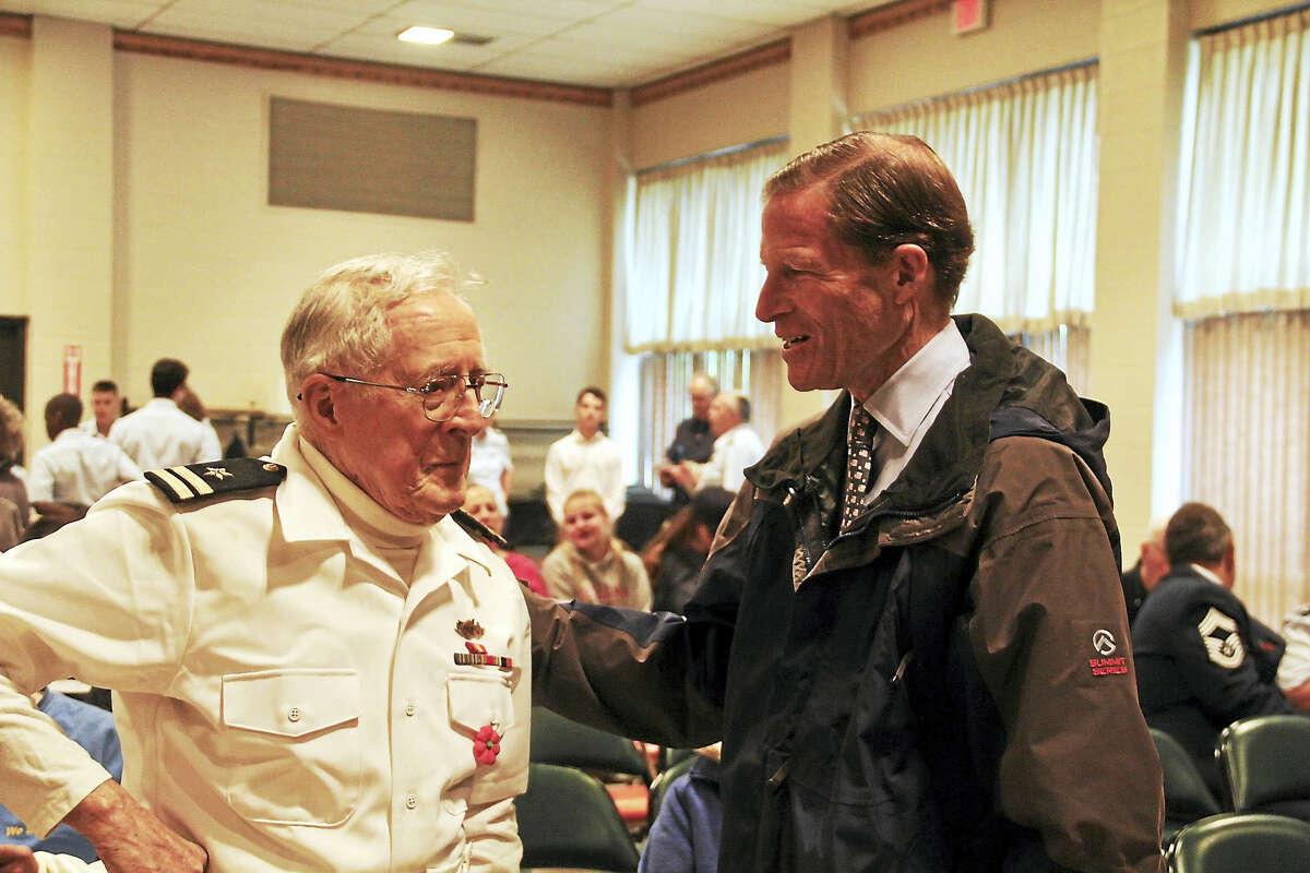 U.S. Sen. Richard Blumenthal talks with Jack McGrane, 93, a veteran of World War II, at Torrington's Memorial Day ceremony on Monday.