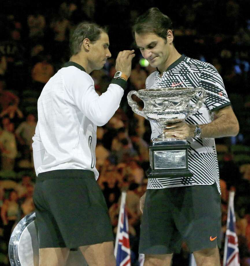 Switzerland's Roger Federer, right, holds his trophy after defeating Spain's Rafael Nadal, left, during their men's singles final at the Australian Open tennis championships in Melbourne, Australia, Sunday. Photo: Aaron Favila — The Associated Press  / Copyright 2017 The Associated Press. All rights reserved.