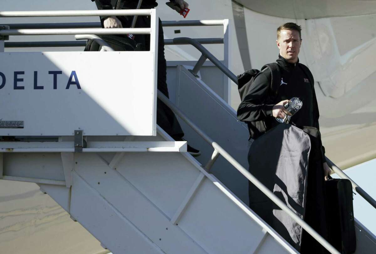 The Falcons' Matt Ryan gets off the plane as the team arrives at George Bush Intercontinental Airport in Houston on Sunday.