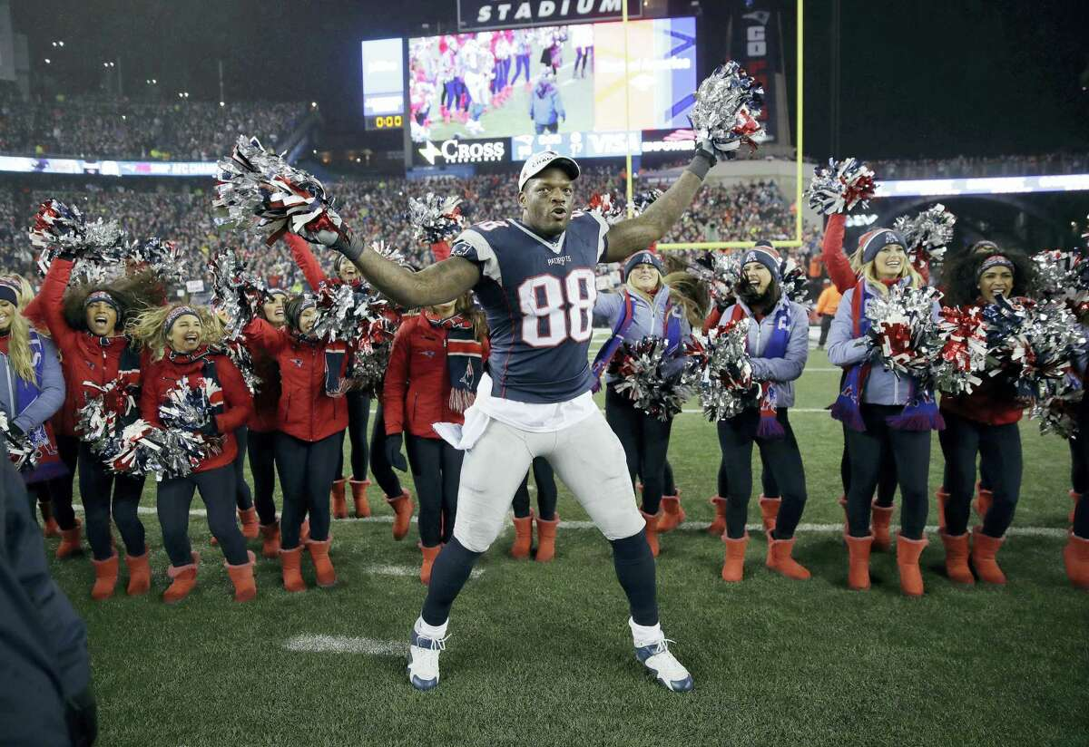 Patriots tight end Martellus Bennett celebrates with cheerleaders after the AFC championship game.