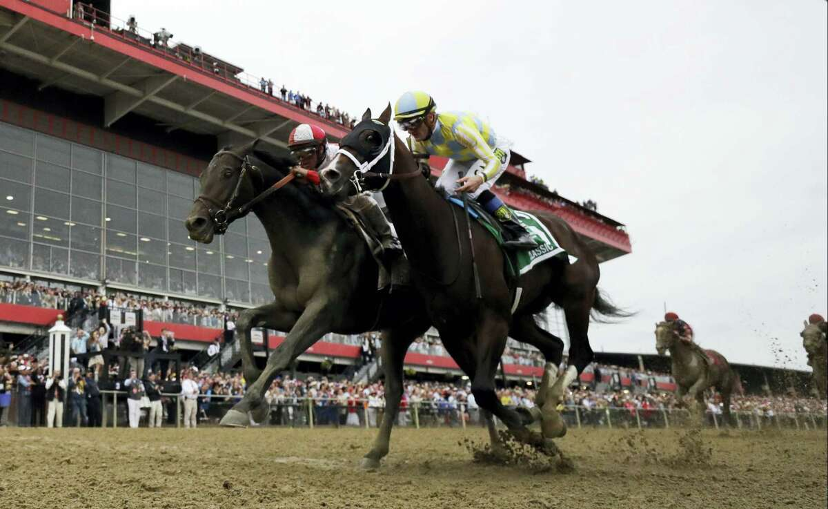 Cloud Computing (2), ridden by Javier Castellano, left, wins 142nd Preakness Stakes horse race at Pimlico race course as Classic Empire (5) with Julien Leparoux aboard takes second on Saturday, May 20, 2017 in Baltimore.