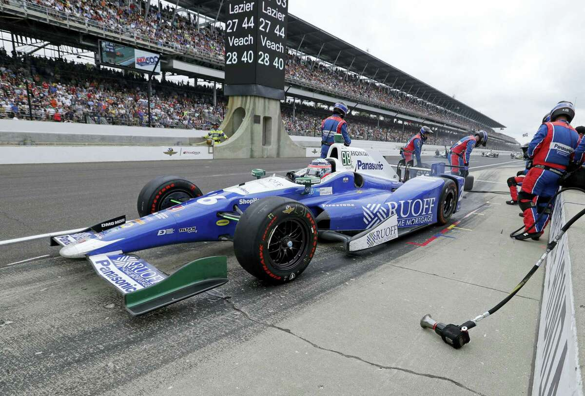Takuma Sato leaves the pit area after a pit stop.