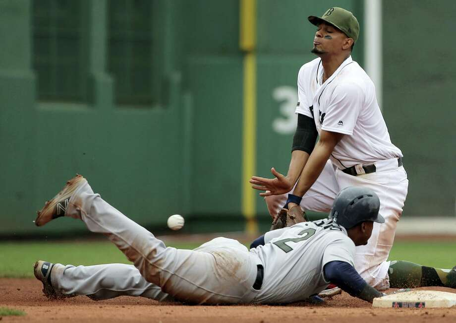 The Mariners' Jean Segura is safe at second base on a pick-off attempt in the ninth inning Sunday. Photo: Steven Senne — The Associated Press  / Copyright 2017 The Associated Press. All rights reserved.