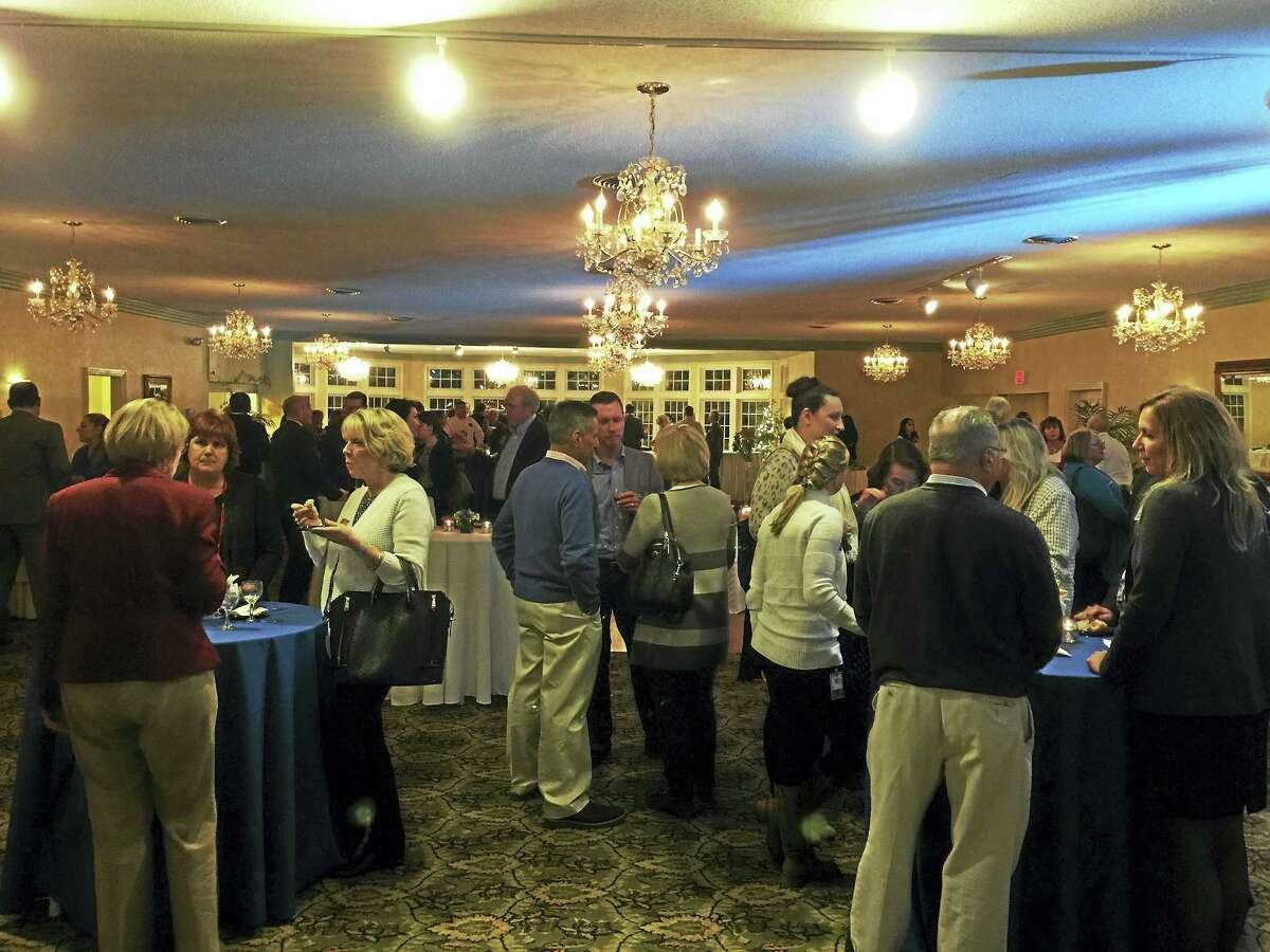 """Ben Lambert - The Register Citizen Attendees mingle at the """"New Year New Chamber"""" event held by the Northwest Connecticut Chamber of Commerce Thursday in Torrington."""
