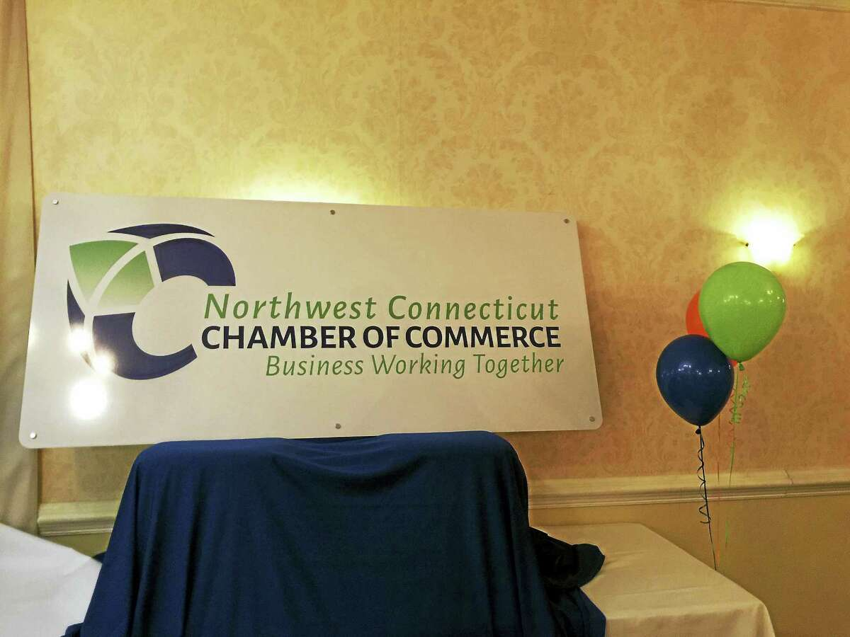"""Ben Lambert - The Register Citizen Part of the """"New Year New Chamber"""" Northwest Connecticut Chamber of Commerce celebration included unveiling a new logo for the organization."""