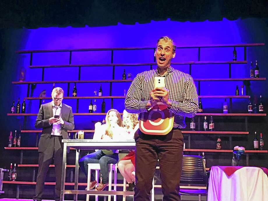 "Jimmy Donahue as the waiter performs a scene from the Goshen Players' production of the musical comedy, ""First Date,"" which opens Friday night at the Old Town Hall in Goshen. Photo: Contributed Photos"
