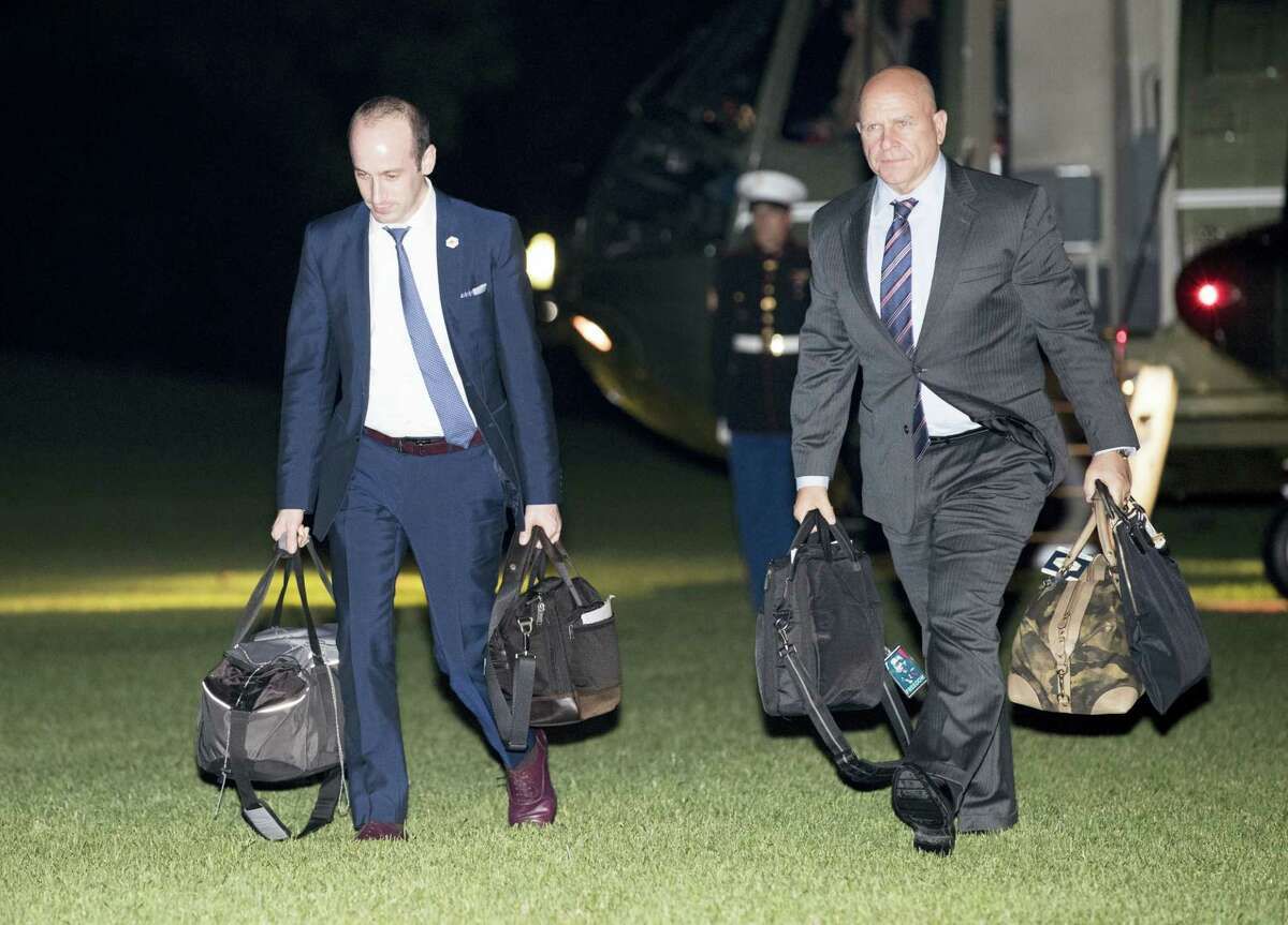 Stephen Miller, senior adviser to President Donald Trump, left, and National Security Adviser H.R. McMaster walk from Marine One across the South Lawn to White House in Washington on May 27, 2017 as they return from Sigonella, Italy with President Donald Trump and first lady Melania Trump.