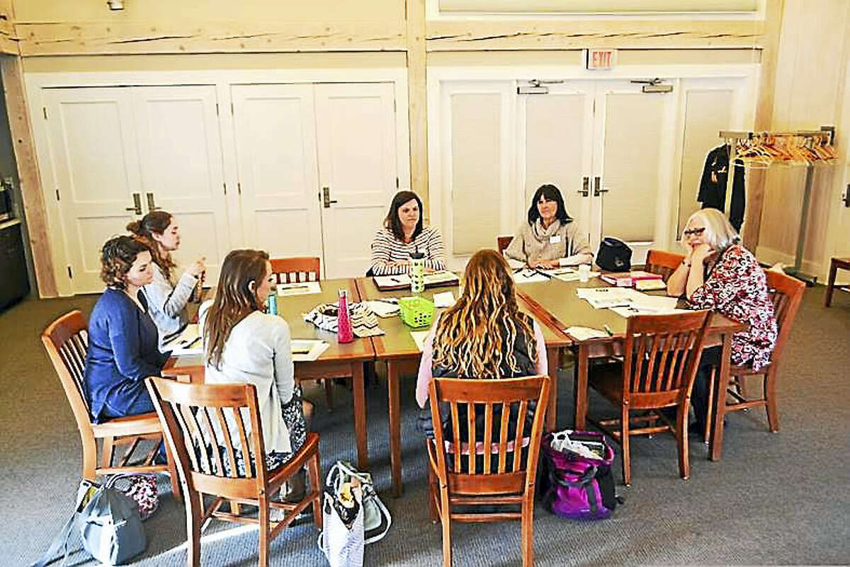 Above, participants take part in a recent training session at the West Cornwall Library.