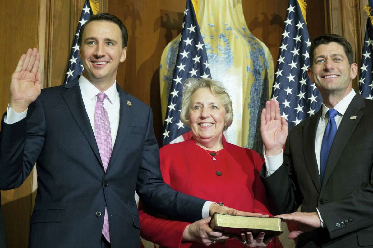In this Jan. 3, 2017 photo, House Speaker Paul Ryan of Wis. administers the House oath of office to Rep. Ryan Costello, R-Pa., during a mock swearing in ceremony on Capitol Hill in Washington. Democrats hope to enlist military veterans in another type of fight — for majority control of the House. In the Philadelphia suburbs, former Air Force officer Chrissy Houlahan is challenging Costello in one of 23 districts where Democrat Hillary Clinton topped Trump in November.