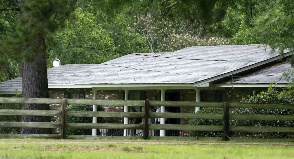 Investigators stand outside a Brookhaven, Miss., home Sunday, May 28, 2017, where several people were killed during shootings Saturday at multiple locations in rural Lincoln County.