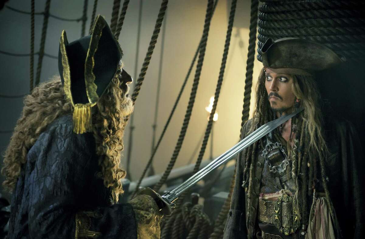 """In this image released by Disney, Geoffrey Rush portrays Barbossa, left, and Johnny Depp portrays Captain Jack Sparrow in a scene from """"Pirates of the Caribbean: Dead Men Tell No Tales."""""""