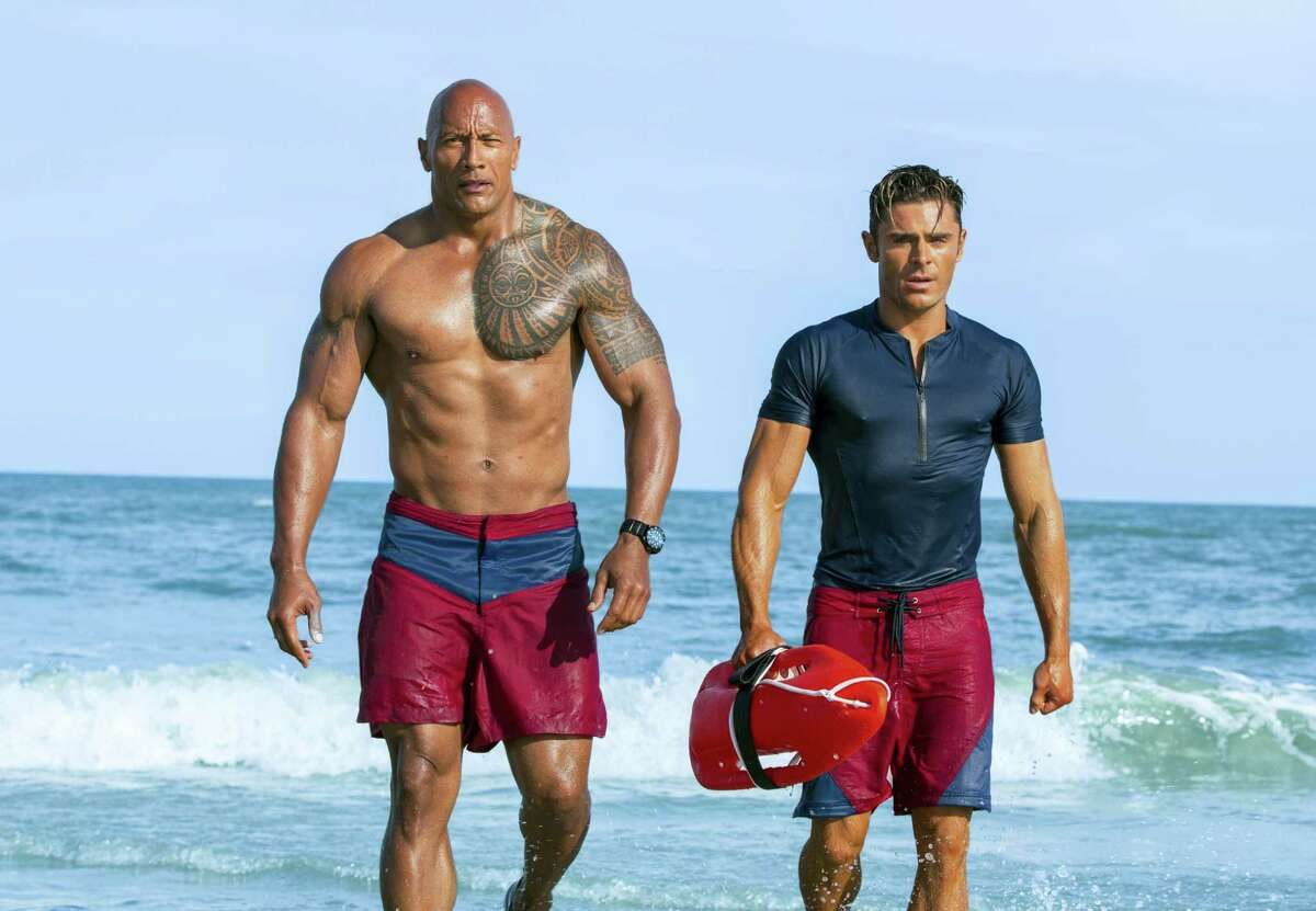 """This image released by Paramount Pictures shows Dwayne Johnson as Mitch Buchannon, left, and Zac Efron as Matt Brody in """"Baywatch."""""""