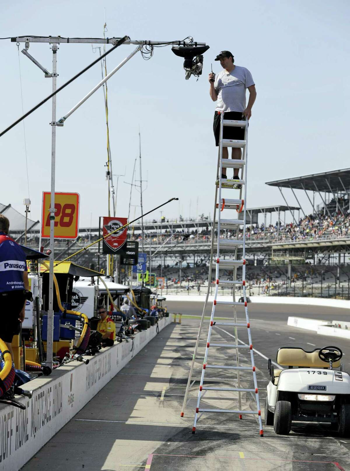 A technician checks on one the dozens of television cameras used for during the broadcast of the Indianapolis 500.
