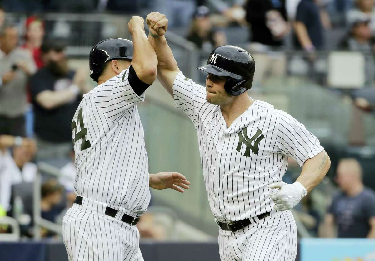 The Yankees' Matt Holliday, right, celebrates with Gary Sanchez, left after hitting a two-run home run in the sixth inning Saturday.